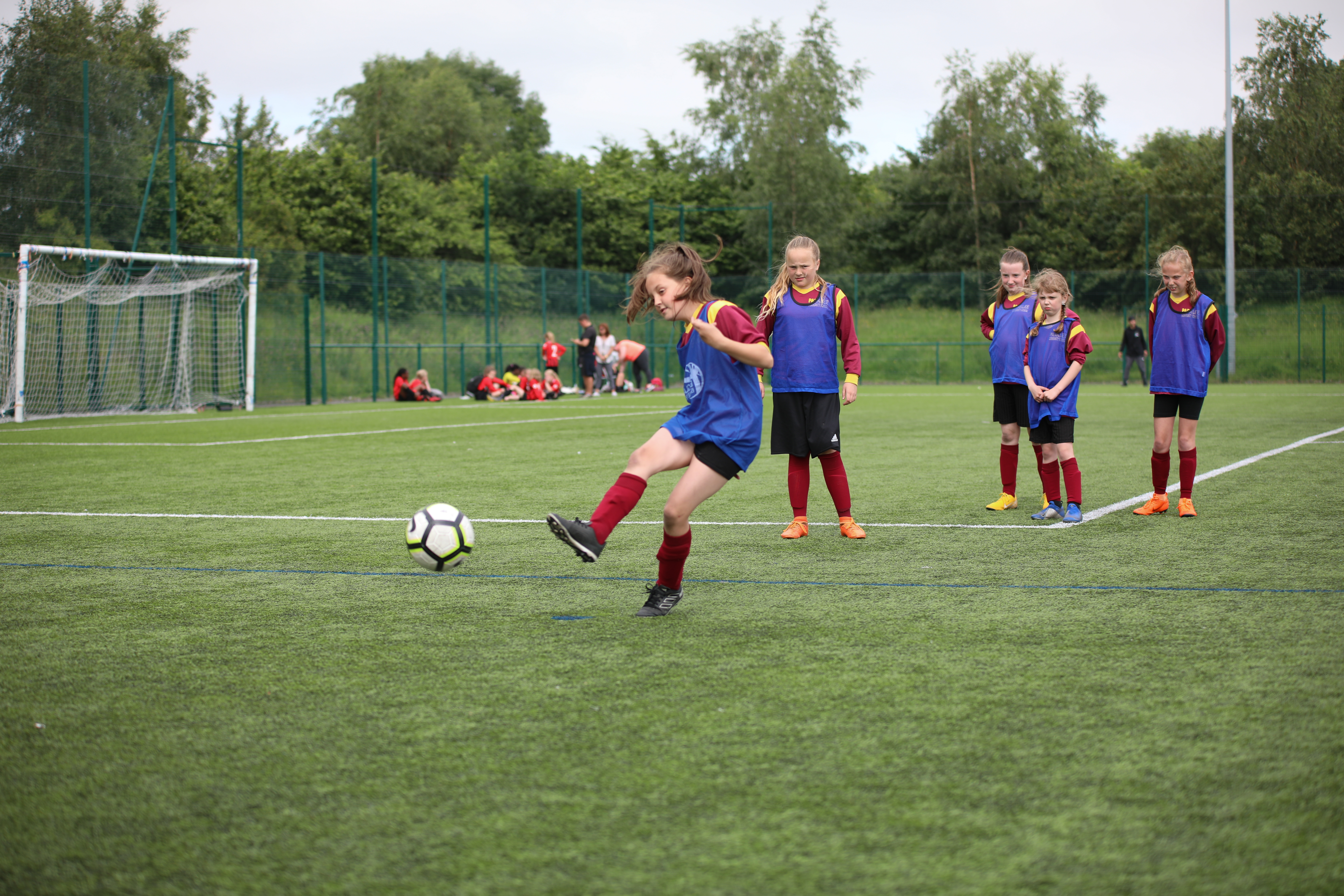 Group of young girls playing football